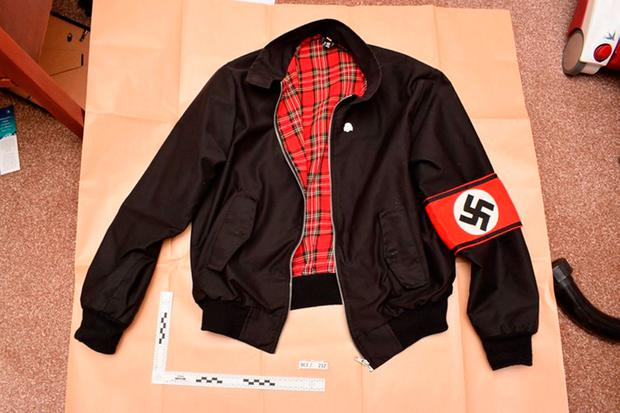Undated handout file photo issued by West Midlands Police of a jacket bearing a Swastika armband found during police searches of Adam Thomas and Claudia Patatas' home.West Midlands Police/PA Wire