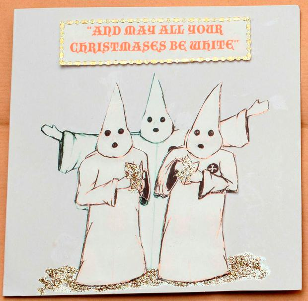 Undated handout file photo issued by West Midlands Police of a Ku Klux Klan-styled Christmas card found on the side board during police searches of Adam Thomas and Claudia Patatas' home. West Midlands Police/PA Wire