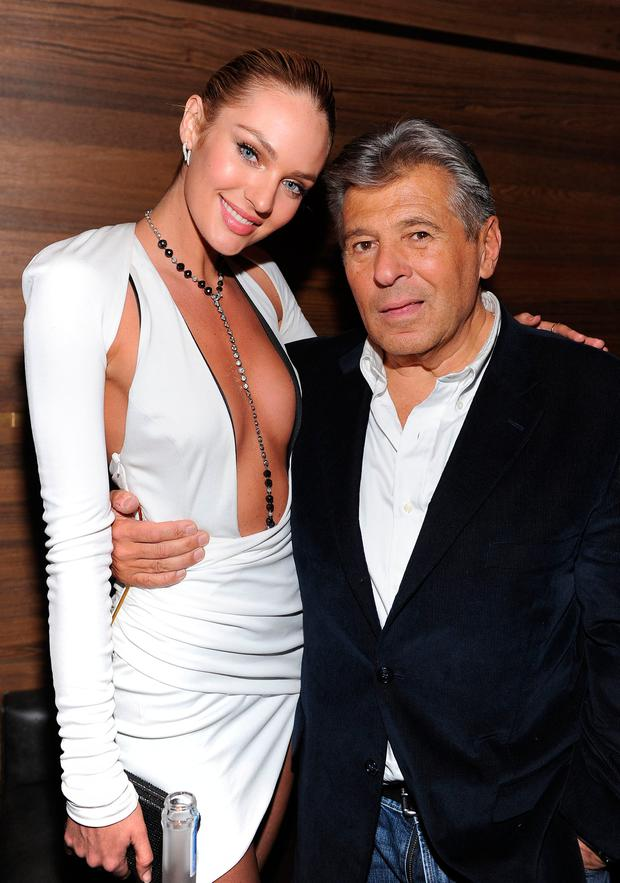 Model Candice Swanepoel and President and Chief Marketing Officer of Victoria's Secret Ed Razek attend the 2013 Victoria's Secret Fashion after party at TAO Downtown on November 13, 2013 in New York City. (Photo by Dimitrios Kambouris/Getty Images for Victoria's Secret)