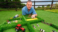 Padraic Cuddy with some of his toy fields, which he was inspired to make by his then three-year-old son, Tommy