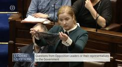 TD Ruth Coppinger holds up a black thong in the Dáil