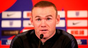 Defiant: Wayne Rooney. Photo: PA