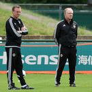 Northern Ireland manager Michael O'Neill (L) and assistant coach Jimmy Nicholl (2ndL) pictured at a training session during Euro 2016. Photo: AFP/Getty Images