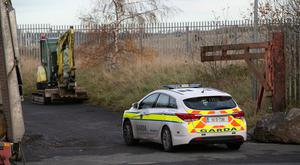 Hunt: Garda activity at an area on Cement Road, Drogheda, included searches using a digger. Picture: Kyran O'Brien