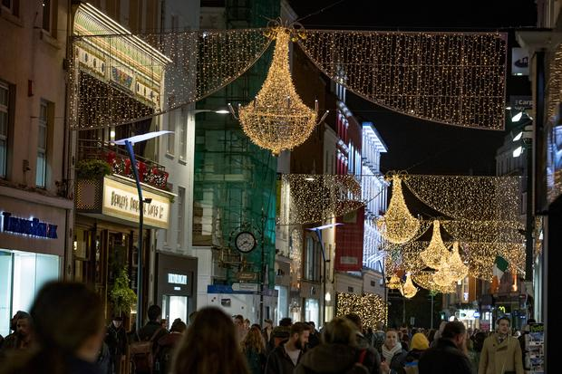 Winter wonderland: Pedestrians walking under the Christmas lights on Dublin's Grafton Street last night. Picture: Arthur Carron