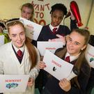From left: Anna Mary Zibangwana, Nicole Forrester, Jasmin Dempsey, Alison Tongui, Stephanie Boylan and Tayler Rooney from Stanhope Street Secondary School show what they want to study in college during College Awareness Week PHOTO COLIN O'RIORDAN