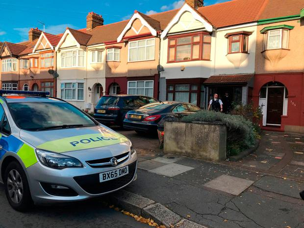 Police at a property in Applegarth Drive, Ilford, east London, where heavily pregnant Devi Unmathallegadoo, 35, was fatally shot with a crossbow, medics managed to deliver her son in hospital. Emma Bowden/PA Wire
