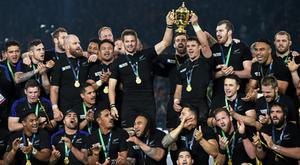 The New Zealand squad celebrates winning the Rugby World Cup in 2015, but many familiar faces like Richie McCaw and Dan Carter are gone