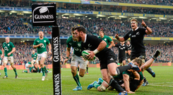 24 November 2013; New Zealand's Ryan Crotty goes over for his side's final try despite the tackle of Ireland's Conor Murray. Guinness Series International, Ireland v New Zealand, Aviva Stadium, Lansdowne Road, Dublin. Picture credit: Stephen McCarthy / SPORTSFILE