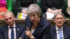 A still image from a video footage shows Britain's Prime Minister Theresa May speaking during Prime Minister's Questions in the House of Commons, in central London, Britain