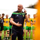 Donegal manager Declan Bonner has an on-pitch debrief with his players after their quarter-final defeat to Dublin last summer, which left the Ulster champions under early pressure in the 'Super 8' series. Photo: Sportsfile