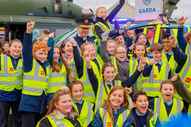 Hi-vis jackets: Garda Commissioner Drew Harris and pupils from Kilbeggan National School launch the 'Be Safe, Be Seen' campaign. Photo: Jeff Harvey