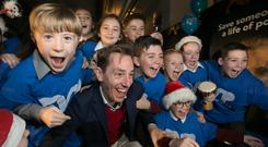 Christmas cheer: Broadcaster Ryan Tubridy launches the St Vincent de Paul appeal with pupils from St Margaret's NS, Dublin, and St Joseph's Primary, Tipperary. Photo: Colm Mahady/Fennells