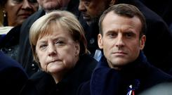 United stand: Angela Merkel and Emmanuel Macron are supporting the creation of a European Union army that would be independent of Nato. Photo: Benoit Tessier