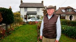 Doubts: Patrick Manning in the front garden of his home on the Navan Road. Photo: Frank McGrath