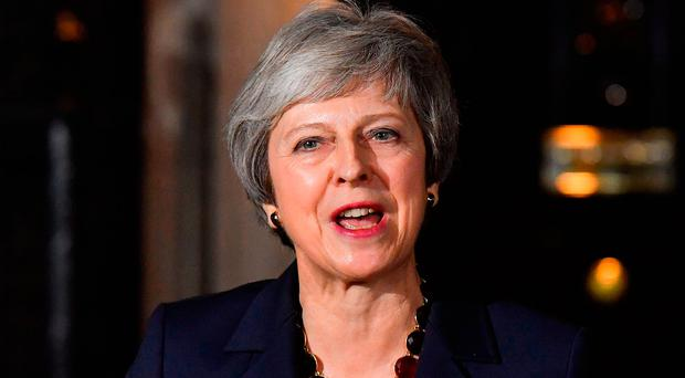 Brave face: Britain's Prime Minister Theresa May gives a statement outside 10 Downing Street in London last night. Photo: AFP/Getty Images