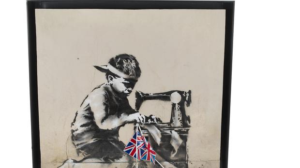 An American artist paid 730,000 US dollars (£561,000) for a Banksy artwork painted on the side of a North London Poundland (Julien's Auctions/PA)
