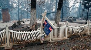 A fence destroyed by the Camp Fire is seen in Paradise, California, U.S., November 14, 2018. REUTERS/Terray Sylvester