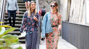 Demi Harmon (L), wearing Kate Sylvester dress, Vintage jacket and Jeffrey Campbell shoes, arrives ahead of the KITX show at Mercedes-Benz Fashion Week