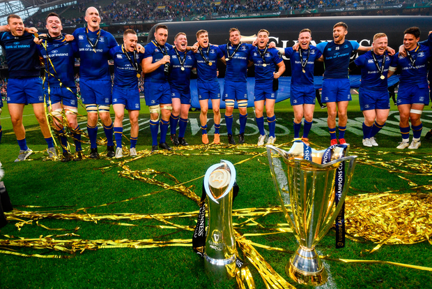 The Leinster rugby team celebrate with the Champions Cup and PRO14 trophy last year