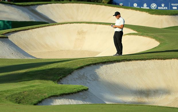 Francesco Molinari of Italy stands on the 15th hole during day one of the DP World Tour Championship at Jumeirah Golf Estates in Dubai. (Photo by Andrew Redington/Getty Images)
