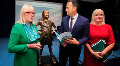 (L to R) Chair of the gender equality task force Marie O'Connor, An Taoiseach Leo Varadkar and Minister of State with special responsibility for Higher Education, Mary Mitchell O'Connor beside a statue of the 'Fearless Girl' during the launch of the Gender Action Plan 2018-2020: Accelerating Gender Equality in Irish Higher Education Institutions at the National Gallery of Ireland, Dublin. Photo: Gareth Chaney, Collins
