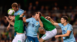 15 November 2018; Darragh Lenihan of the Republic of Ireland in action against Jonny Evans and Gareth McAuley of Northern Ireland during the International Friendly match between Republic of Ireland and Northern Ireland at the Aviva Stadium in Dublin. Photo by Seb Daly/Sportsfile