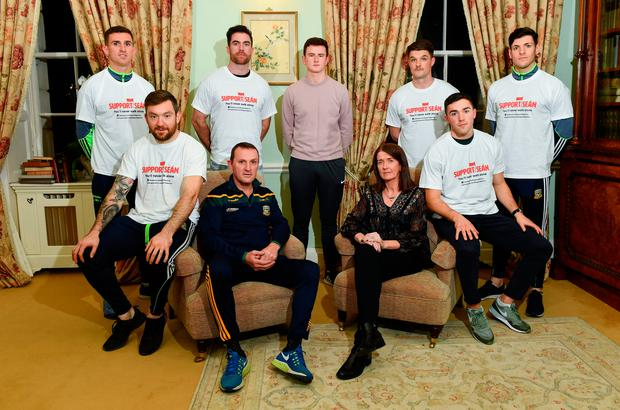 Sean Cox's wife Martina and son Jack (centre) with Meath manager Andy McEntee and players Mickey Burke, Michael Darragh-Macauley, Eric Lowndes, Colm Basquel and Seamus Lavin at Dunboyne Castle last night. Photo: Sportsfile