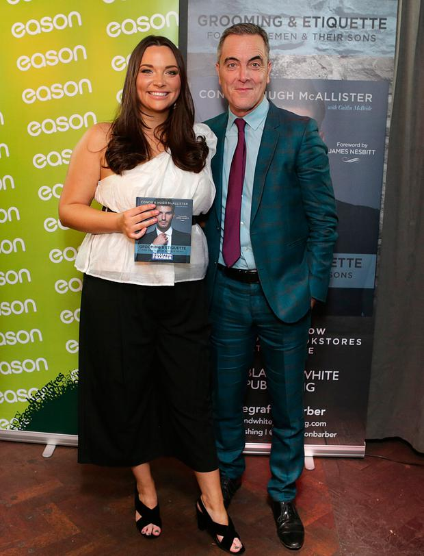Making the cut: Caitlin McBride and actor James Nesbitt at the launch of 'The Grafton Barber Essential Guide to Grooming and Etiquette'. Photo: Damien Eagers/INM