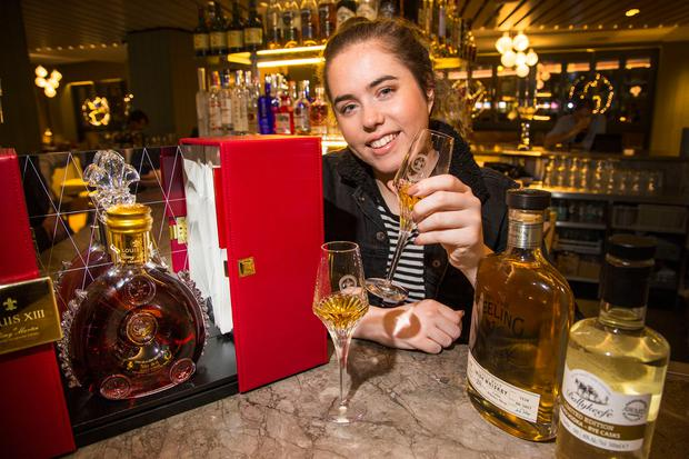 Sláinte: Our reporter Sorcha O'Connor enjoys a tipple from the top shelf at the Morrison Hotel in Dublin