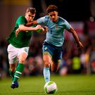 Seamus Coleman fights his way past Northern Ireland's Jamal Lewis during last night's friendly in Dublin. Photo: Stephen McCarthy/Sportsfile