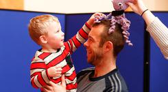 On my head, son: Nathan Thompson with his son Mason (age 2) from Coolock, Dublin, with Tentacles for Tinies at a celebration of premature infants born at Dublin's Rotunda Hospital to mark World Prematurity Day. Photo: Conor Mccabe