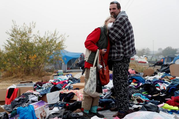 Travis Lee Hogan, of Paradise, comforts his mother, Bridgett Hogan, while they stay at a makeshift evacuation center for people displaced by the Camp Fire in Chico, California, U.S., November 15, 2018. REUTERS/Terray Sylvester