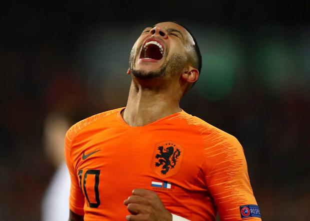 Memphis Depay of the Netherlands celebrates after scoring his team's second goal during the UEFA Nations League Group A match between Netherlands and France at the Stadion Feijenoord on November 16, 2018 in Amsterdam, Netherlands. (Photo by Dean Mouhtaropoulos/Getty Images)
