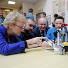 P-Tech launch: Deirdre Butler, DCU professor of digital learning, Ross Maguire, of the Learn It Lego Innovation Studio at DCU, and Virgin Media Ireland CEO Tony Hanway with St Joseph's CBS Fairview students David Lawless and Christian Elliot. Photo: Iain White