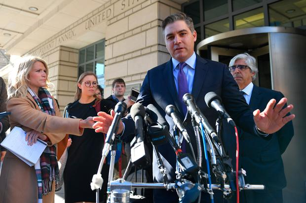 Legal win: CNN's Jim Acosta speaks outside the US District Court in Washington yesterday. Photo: Getty Images