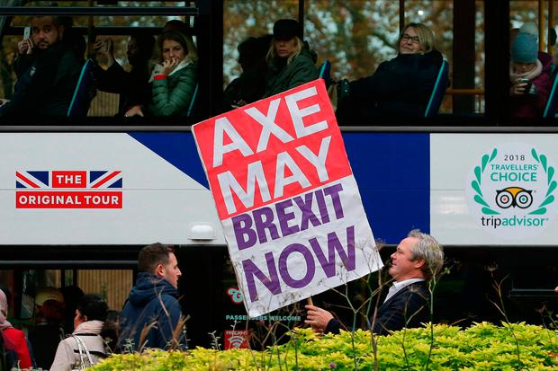 Deal or no deal?: A pro-Brexit supporter with a placard near the Palace of Westminster in London yesterday. Photo: Daniel Leal-Olivas/Getty images