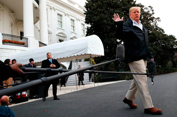 President Donald Trump waves after answering questions from members of the media as he leaves the White House, Saturday Nov. 17, 2018, in Washington, en route to see fire damage in California. (AP Photo/Jacquelyn Martin)