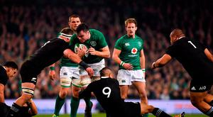 James Ryan of Ireland is tackled by Kieran Read and Aaron Smith of New Zealand during the Guinness Series International match between Ireland and New Zealand at the Aviva Stadium in Dublin. Photo by Brendan Moran/Sportsfile