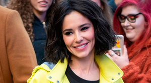 Cheryl returns with her 'lollipop lady' raincoat, new bob and 'new face'. Photo: PA