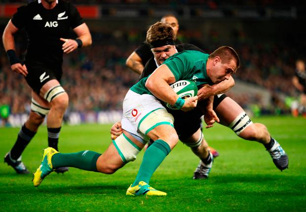 CJ Stander of Ireland is tackled by Scott Barrett of New Zealand All Blacks during the international friendly between Ireland and New Zealand at Aviva Stadium on November 17, 2018 in Dublin, Ireland. (Photo by Phil Walter/Getty Images)