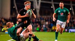 Damian McKenzie of New Zealand is tackled by Keith Earls of Ireland of Ireland during the Guinness Series International match between Ireland and New Zealand at the Aviva Stadium in November. Photo by David Fitzgerald/Sportsfile