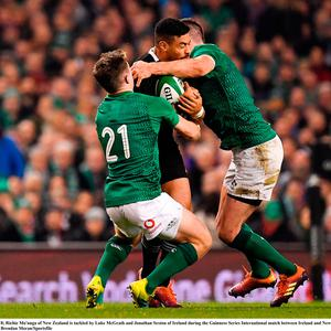 Richie Mo'unga of New Zealand is tackled by Luke McGrath and Jonathan Sexton of Ireland during the Guinness Series International match between Ireland and New Zealand at the Aviva Stadium in Dublin. Photo by Brendan Moran/Sportsfile