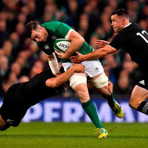Peter O'Mahony of Ireland is tackled by Sam Whitelock and Owen Franks of New Zealand during the Guinness Series International match between Ireland and New Zealand at the Aviva Stadium in Dublin. Photo by Brendan Moran/Sportsfile