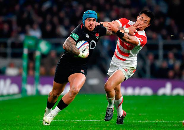 Jack Nowell of England is tackled by Kenki Fukuoka. Photo: Mike Hewitt/Getty Images