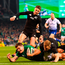 Jacob Stockdale of Ireland scores his side's first try despite the tackle of Damian McKenzie and Aaron Smith of New Zealand. Photo: Ramsey Cardy/Sportsfile