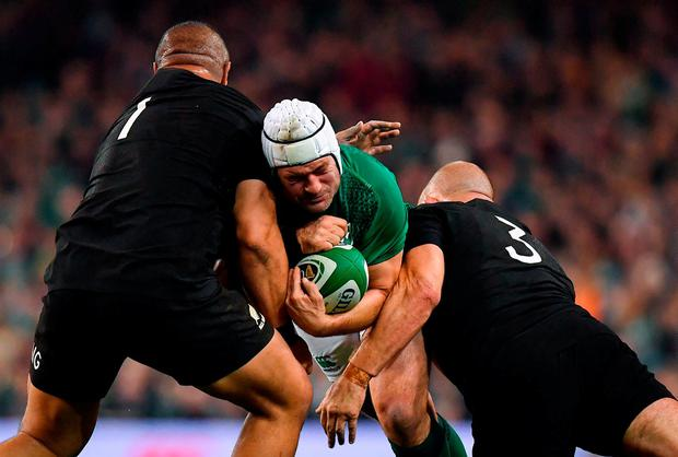 Rory Best of Ireland is tackled by Karl Tu'inukuafe, left, and Owen Franks of New Zealand during the Guinness Series International match between Ireland and New Zealand at Aviva Stadium, Dublin. Photo by Brendan Moran/Sportsfile