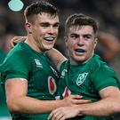 Ireland's Luke McGrath and Garry Ringrose celebrate at the end of the match. REUTERS/Clodagh Kilcoyne