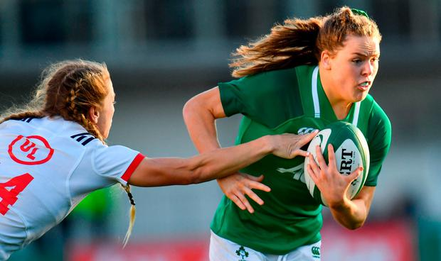 Beibhinn Parsons of Ireland is tackled by Kelsi Stockert of USA during the Women's International Rugby match between Ireland and USA at Energia Park in Donnybrook, Dublin. Photo by Ramsey Cardy/Sportsfile