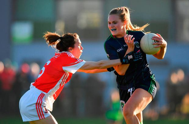 Amy Connolly of Foxrock-Cabinteely in action against Sharon Courtney of Donaghmoyne. Photo by Brendan Moran/Sportsfile